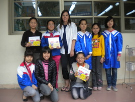Alisa with school kids in Vietnam