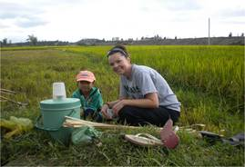Alisa with Vietnamese girl in field